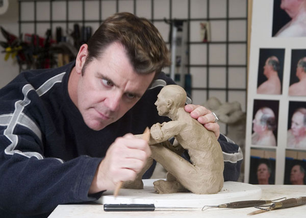 Gregory sculpting the Truth-seeker sculpture